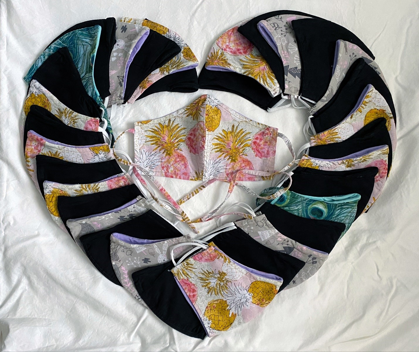 cloth masks laid out in a heart shape